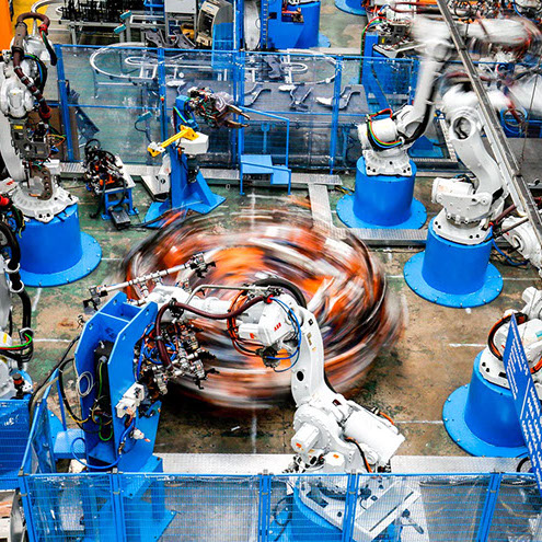 Articulated industrial robot arms operate in sealing at the Gestamp Automocion factory branch in Abrera, near Barcelona, on April 5, 2017.